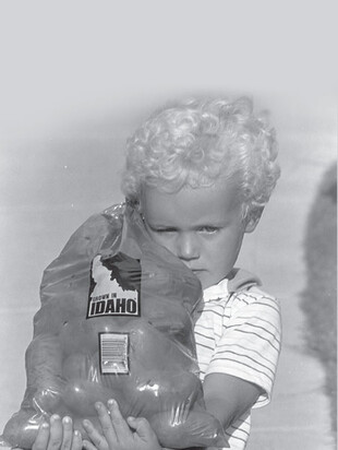 Child with Idaho potatoes