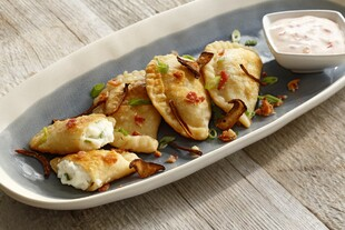 Loaded Potato Pierogi with Mushroom Bacon and Chili Crema