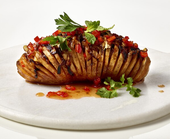 Vegan Hasselback Potato with Red Pepper Jelly and Caramelized Onions