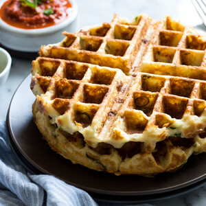 Ham & Cheddar Mashed Potato Waffles with Roasted Red Pepper Sauce