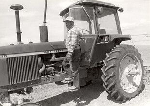 Farmer with enclosed tractor
