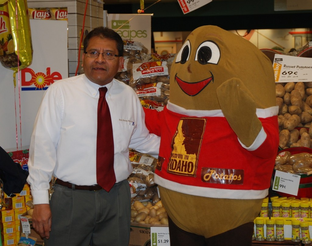 Spuddy Buddy, with a Hen House representative, greeted shoppers during the store's Potato Lover's Month promotions.