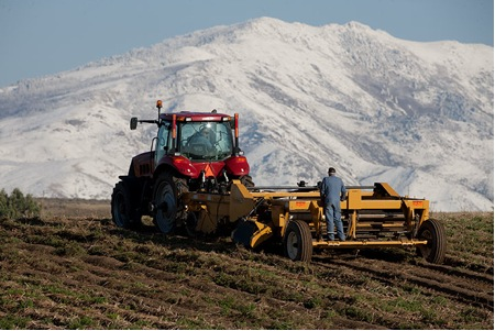 A farmer harvests his field in Tetonia, Idaho. (Photo Courtesy of David Stoecklein)