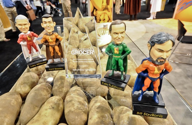 Progressive Grocer's Commodity Board Retail Leadership Award surrounded by the Fearless Field Force bobbleheads.