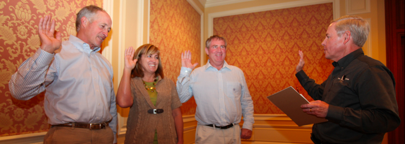 Pat Kole, Vice President of Legal Affairs of the Idaho Potato Commission (right) swears in new commissioners Toevs, Grover and Brown at the IPC's October meeting in Sun Valley, Idaho.